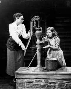 Photo of Anne Bancroft as Annie Sullivan and Patty Duke as Helen Keller in the broadway play The Miracle Worker